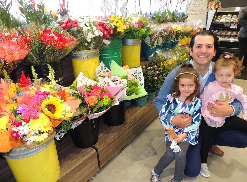 Tottenham - Giancarlo and kids by flower display