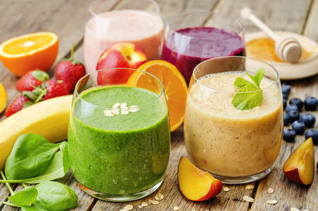 smoothies with spinach; blueberries, peach and strawberries. the toning. selective focus